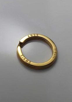 design nyckelring i guld